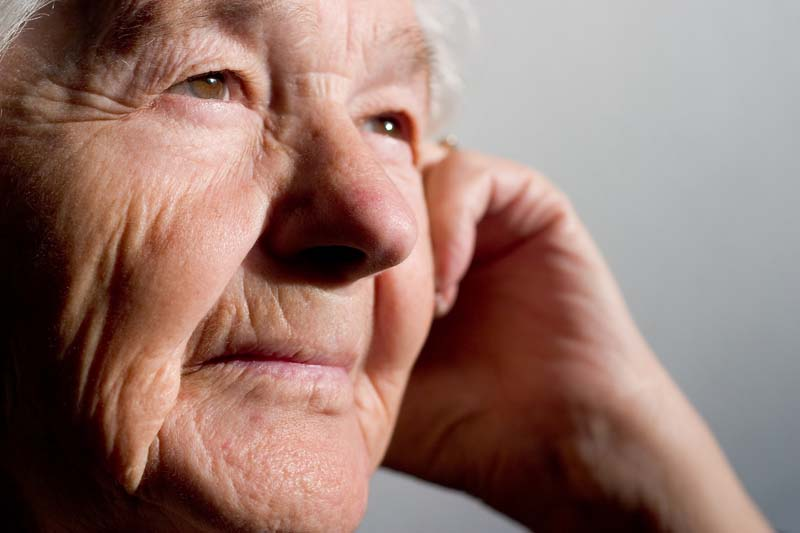 Elderly woman thinking. Focus on the first eye.